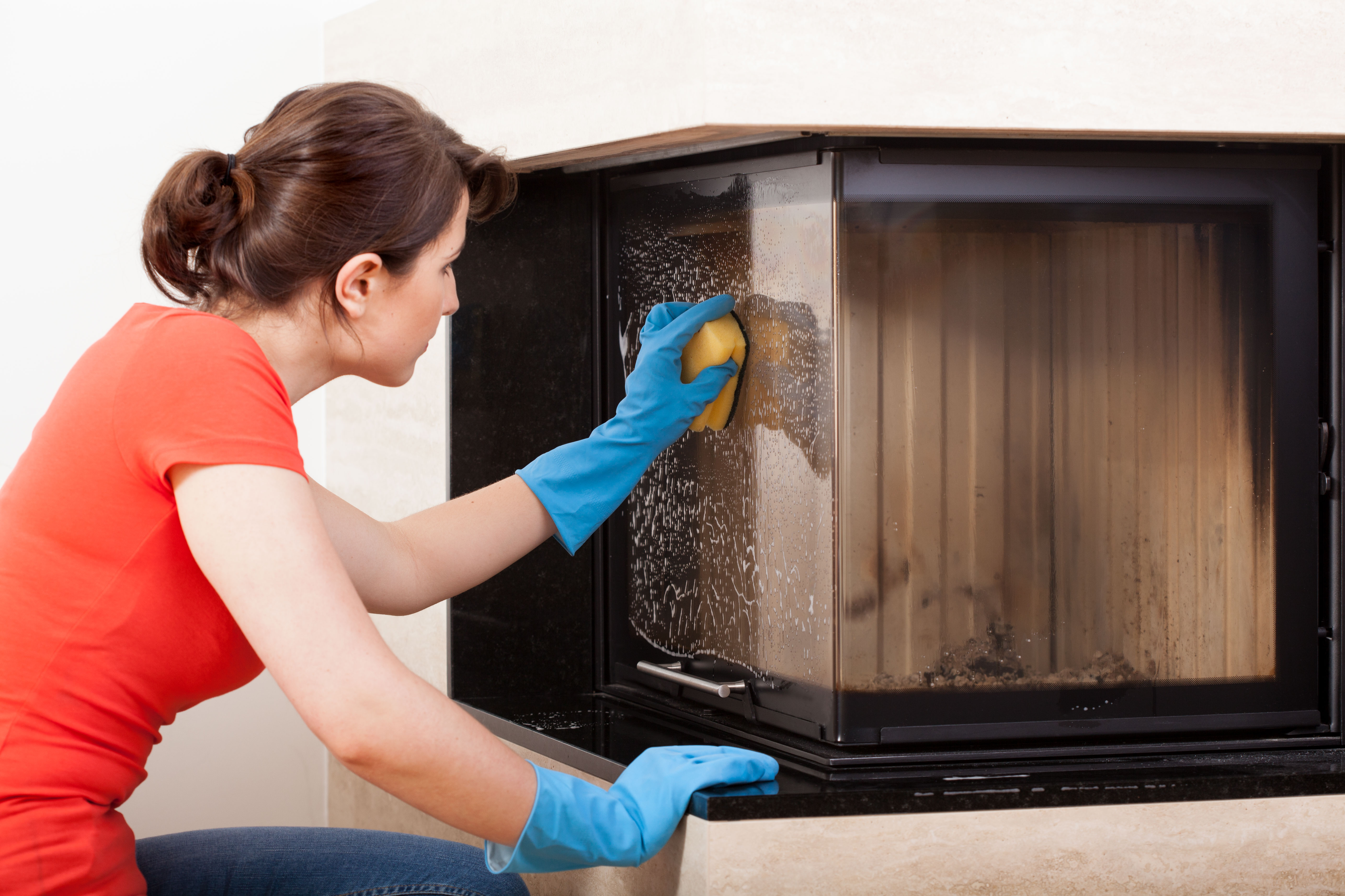 Housekeeper cleaning the fireplace